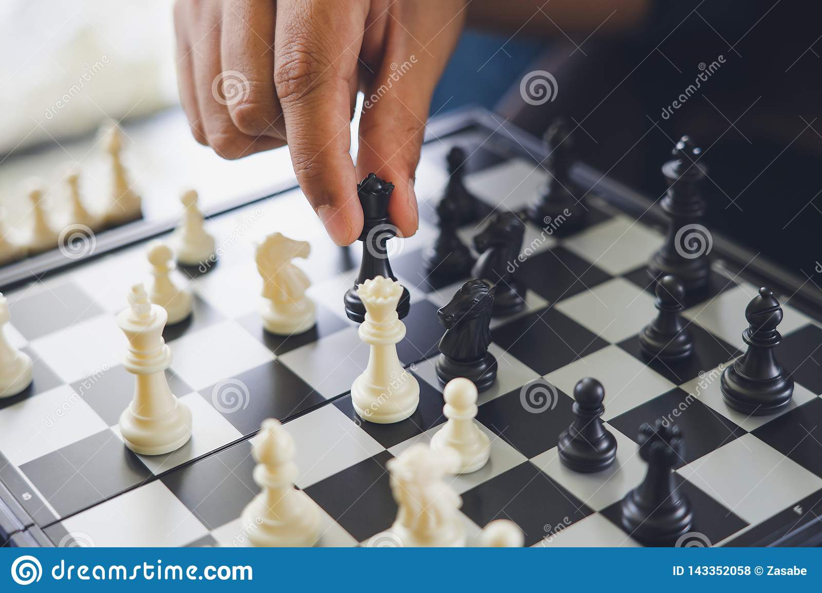 Businessman holding a King Chess is placed on a chessboard.using as background business concept and Strategy concept with copy