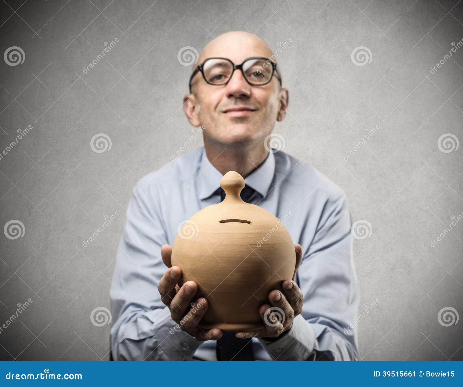 Businessman holding a piggy-bank