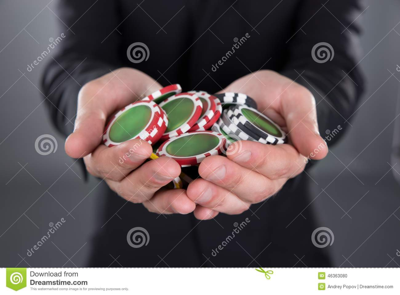 Technology Management Image: Businessman Holding Poker Chips In Cupped Hands Stock