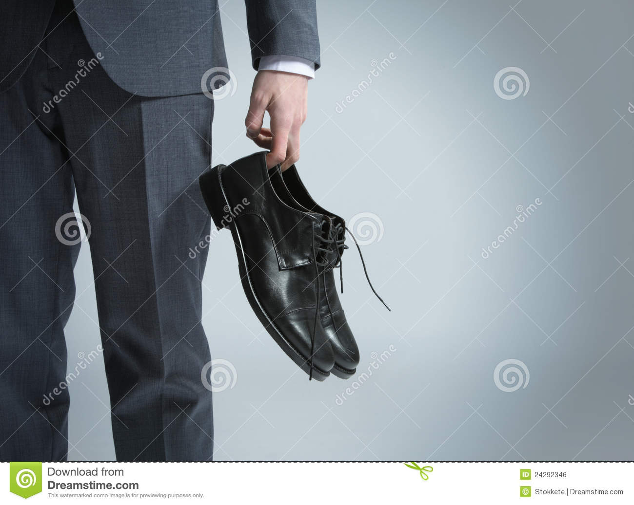 Technology Management Image: Businessman Holding The Shoes In Hand, Stock Photo