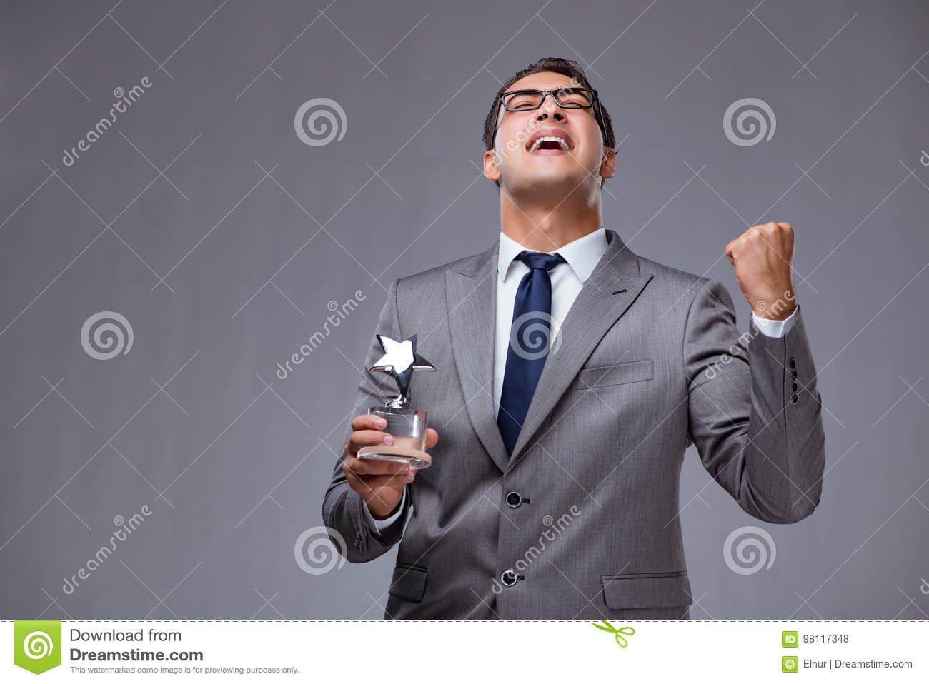 The businessman holding star award in business concept