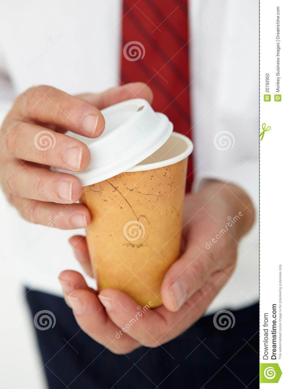 Technology Management Image: Businessman Holding Takeout Coffee Stock Photo