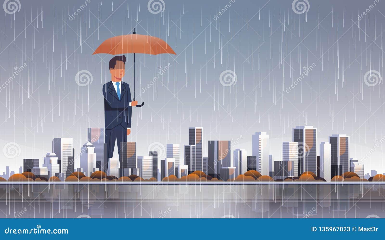 Businessman holding umbrella at storm huge rain business protection concept over big modern city building skyscraper