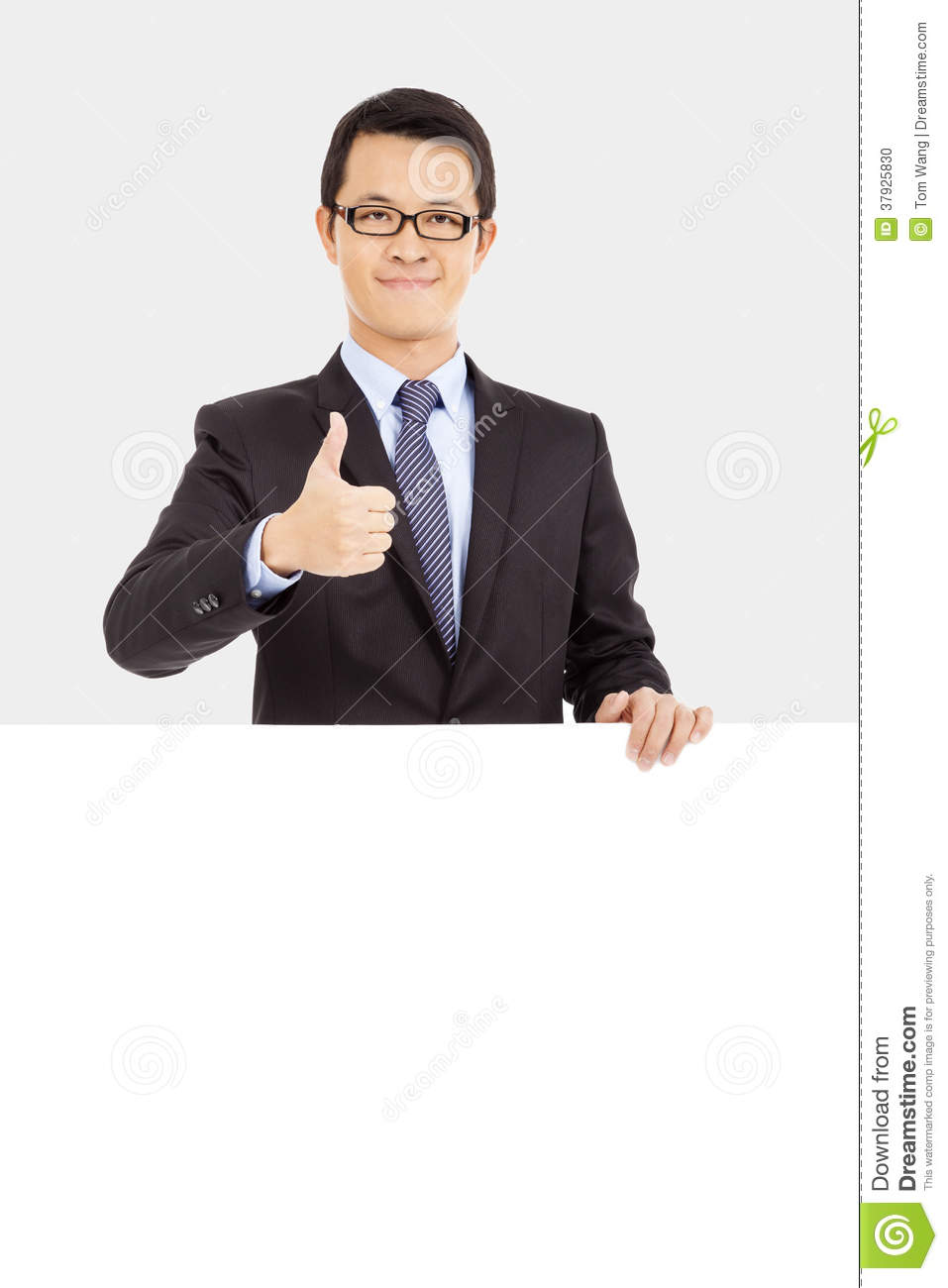 Businessman holding white board and thumb up