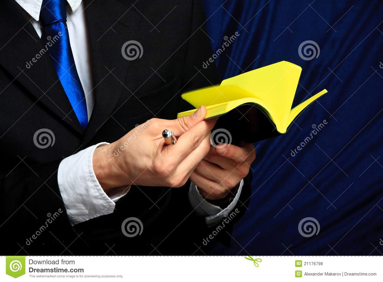 Businessman holds his notebook