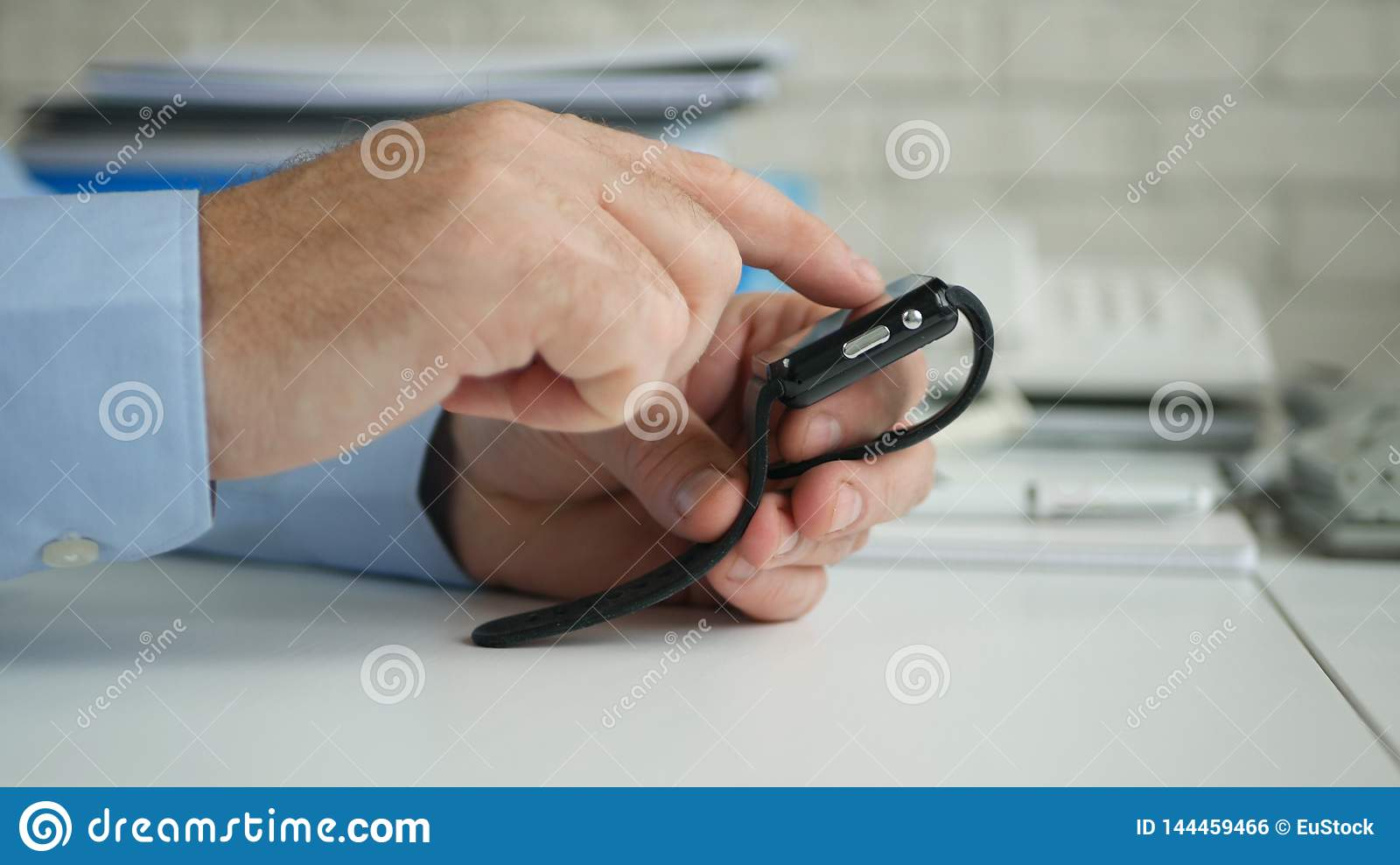 Businessman Image in Office Room Accessing Smartwatch Online Email Application