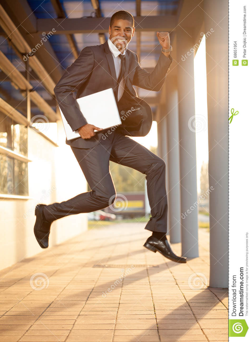 Businessman jumping, happy about the successful conclusion of a