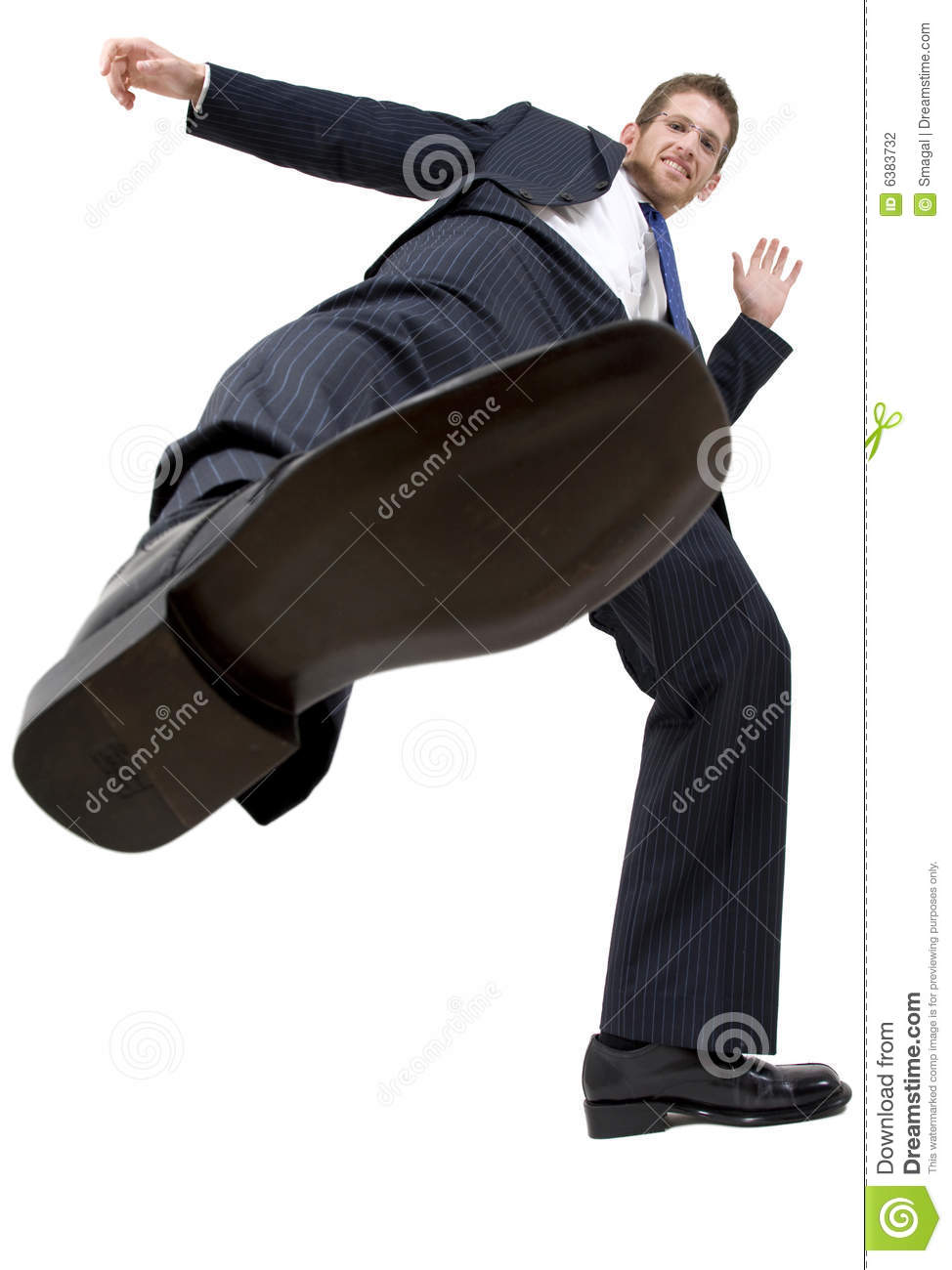 Businessman kicking