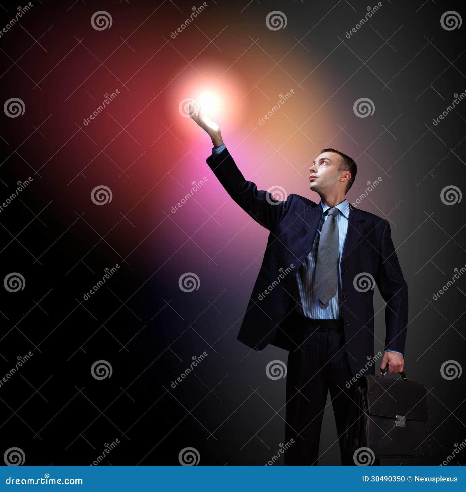 Technology Management Image: Businessman With Light Shining Stock Photo