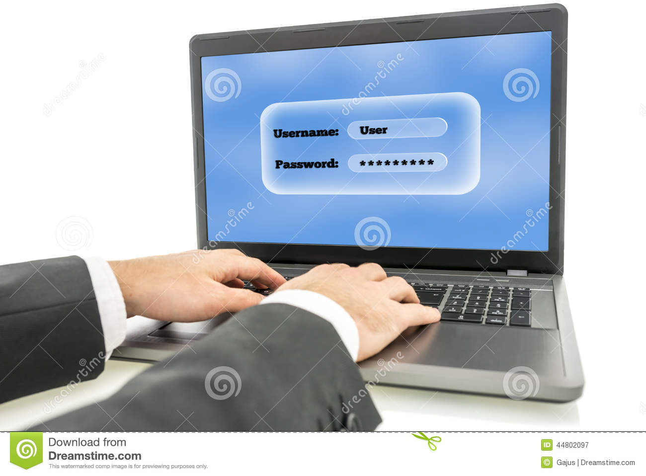 Businessman Logging In On A Laptop Computer Stock Photo