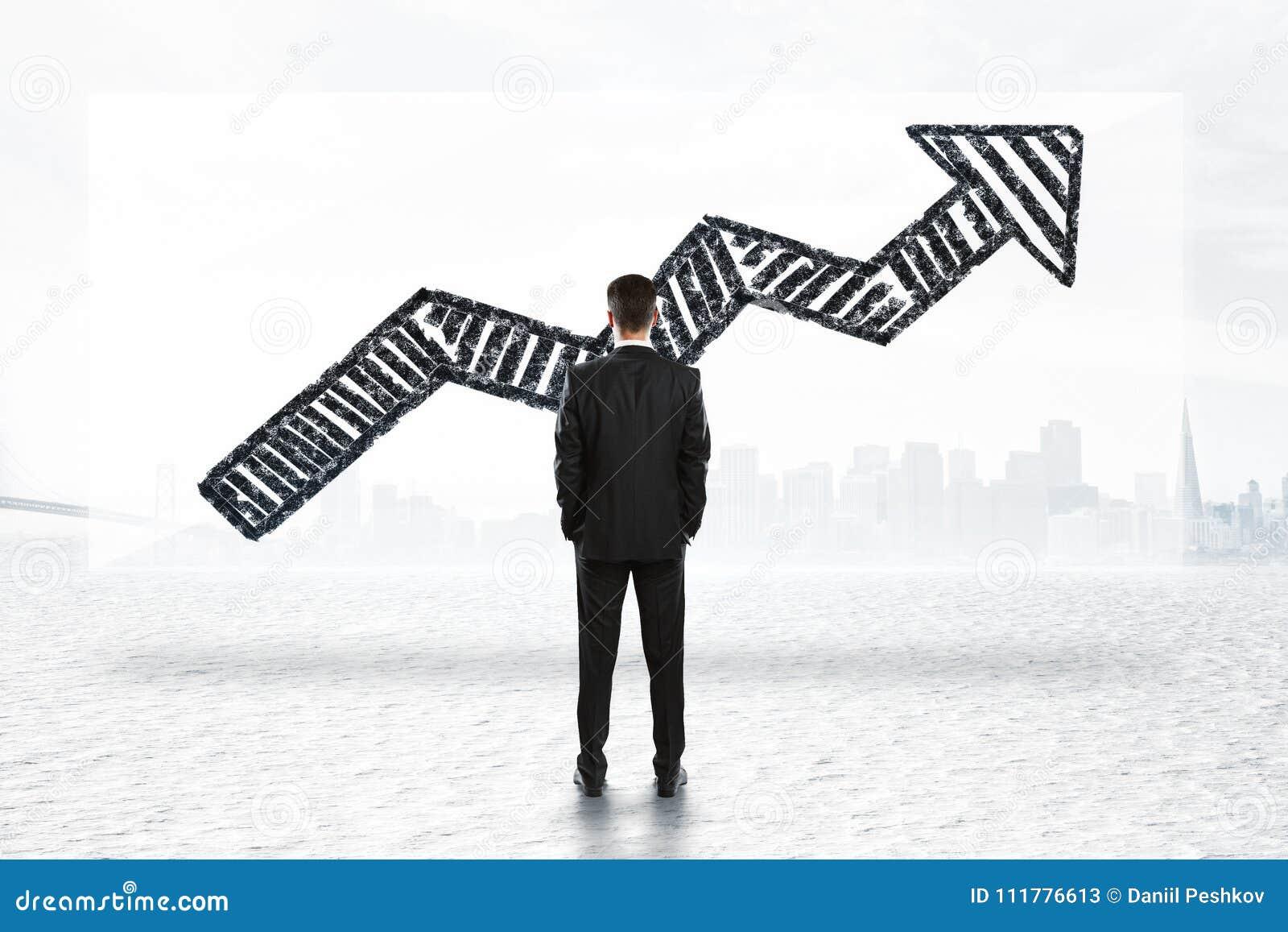 Businessman looking at arrow