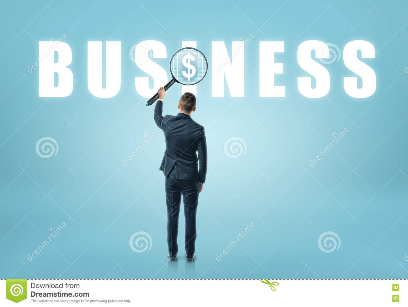 Businessman looking at  business  word with magnifier and seeing dollar sign