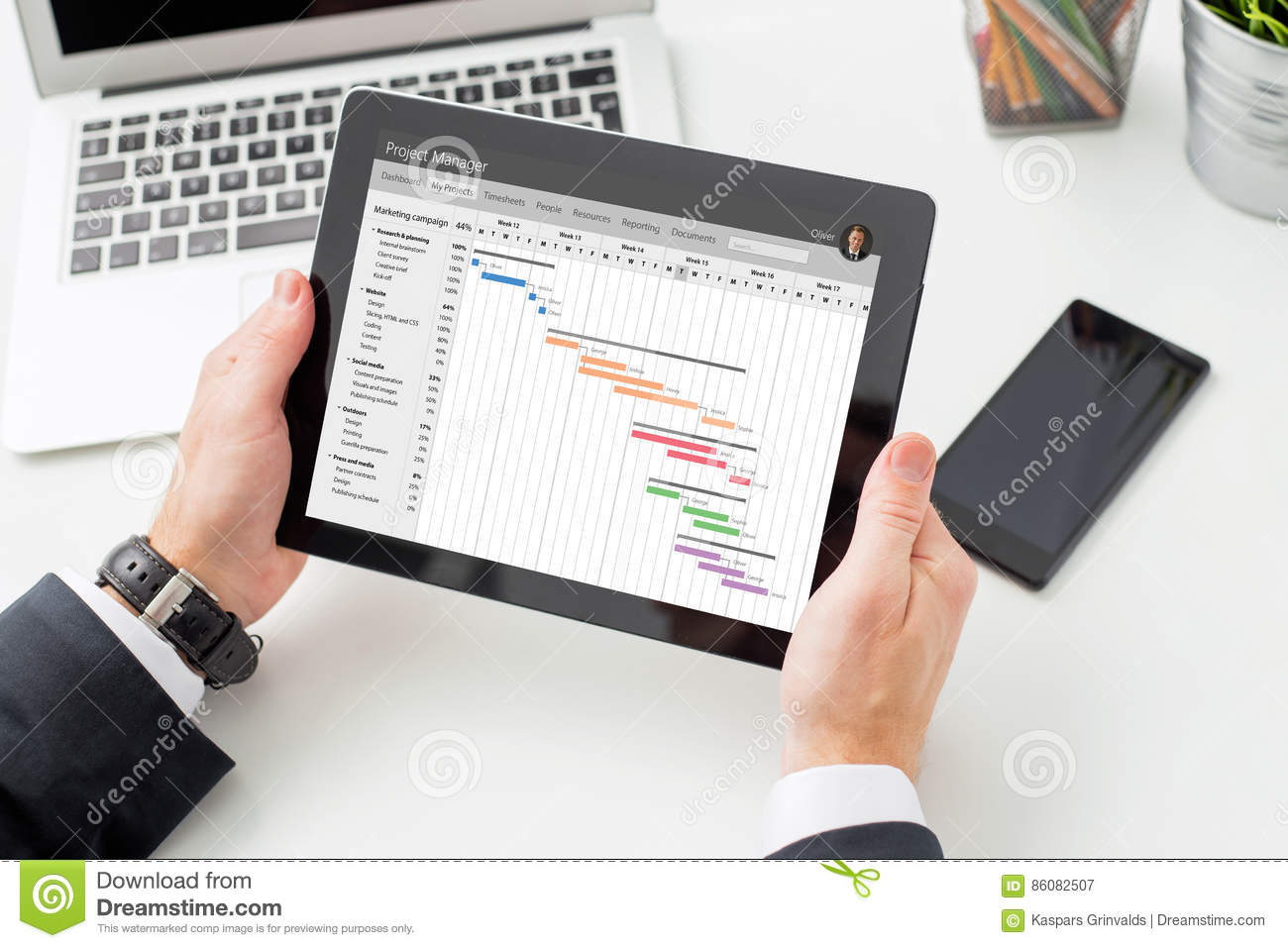 Businessman Looking At Gantt Chart On Tablet Computer Stock Image