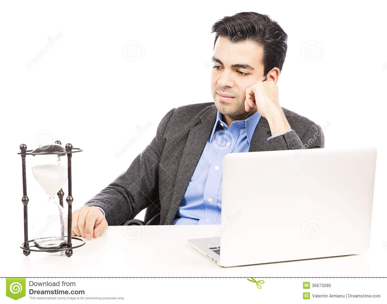Businessman looking at the hour glass