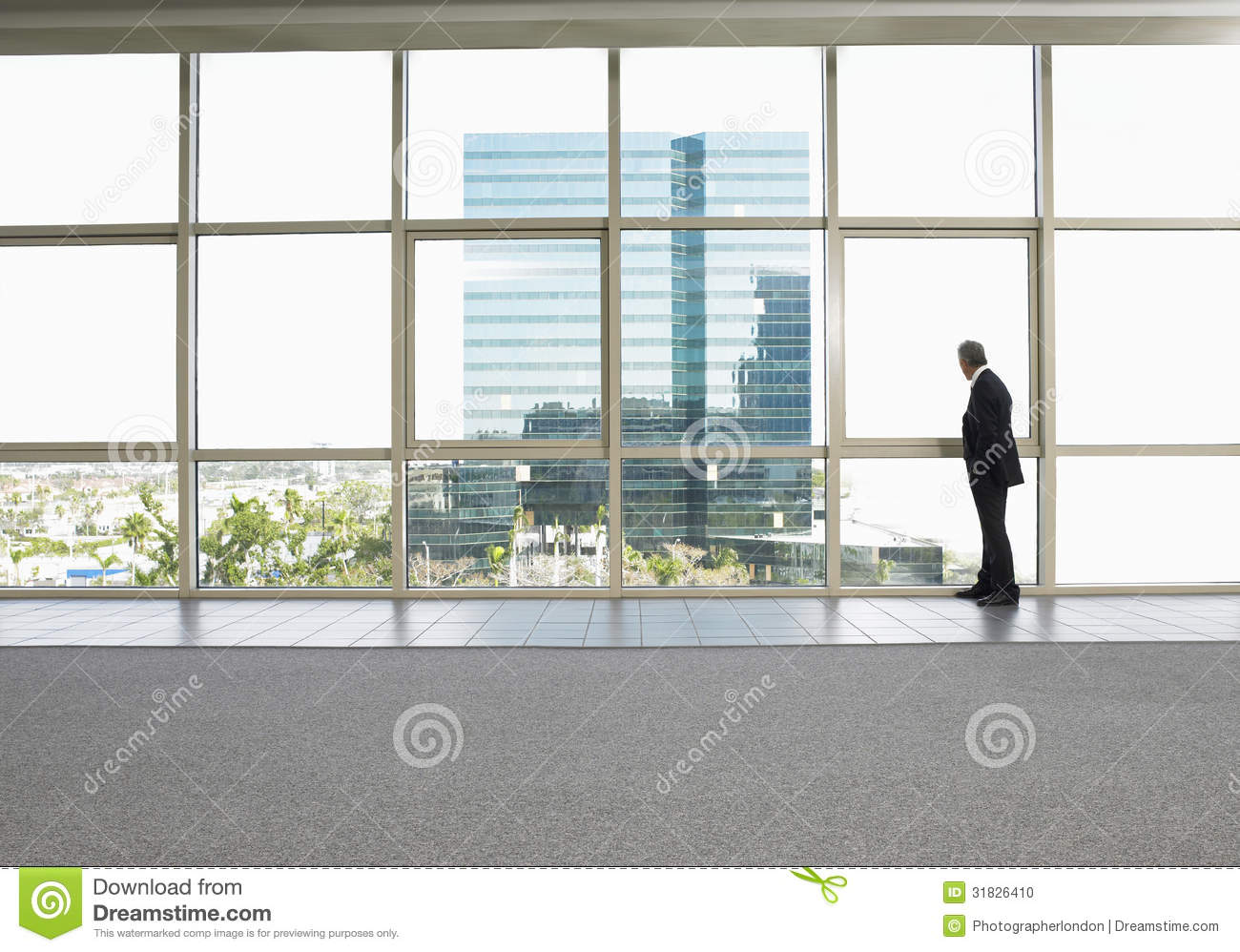 Businessman Looking Out Of Office Window Stock Photo - Image: 31826410