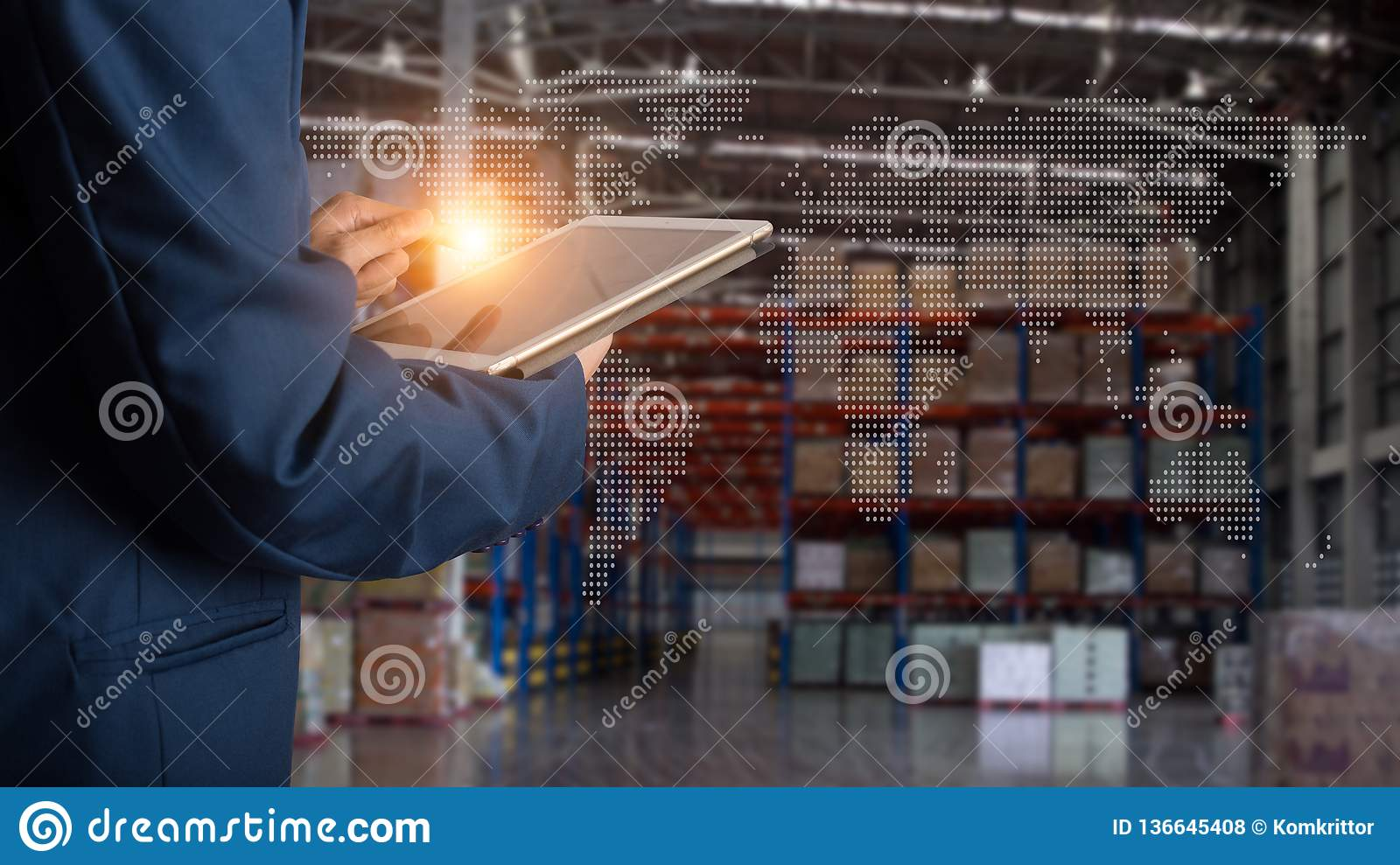 Businessman manager using tablet check and control for workers with Modern Trade warehouse logistics.