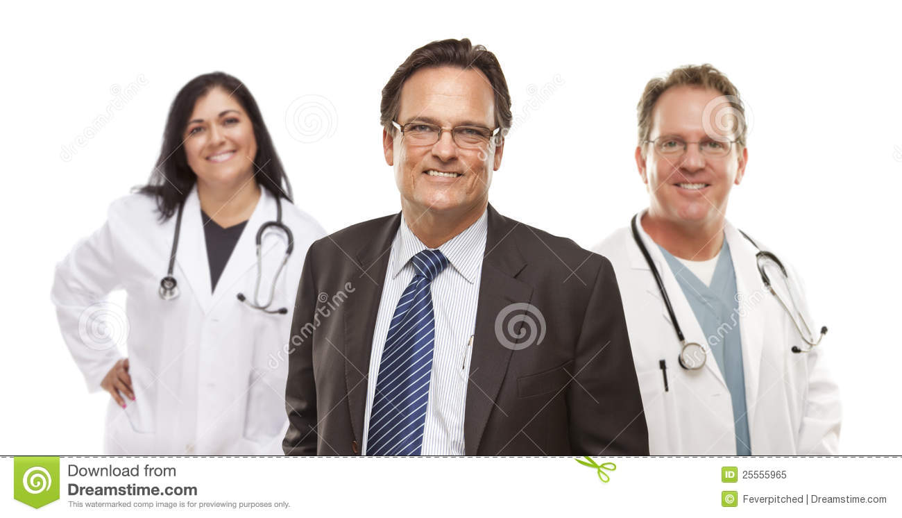 Businessman with Medical Personnel Behind