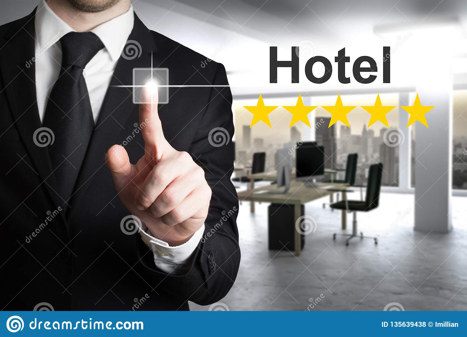 Businessman in modern office pushing touchscreen hotel rating five stars
