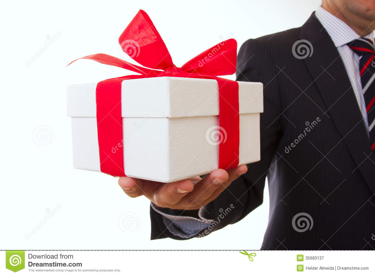 A Businessman Offering Gift To You Selective Focus