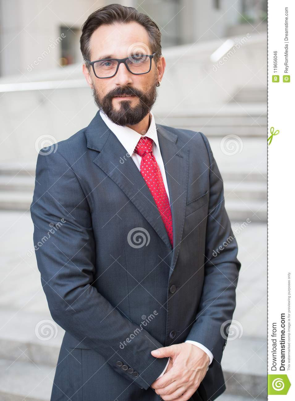 Businessman outdoor on office center background. Successful business person portrait. Professional people