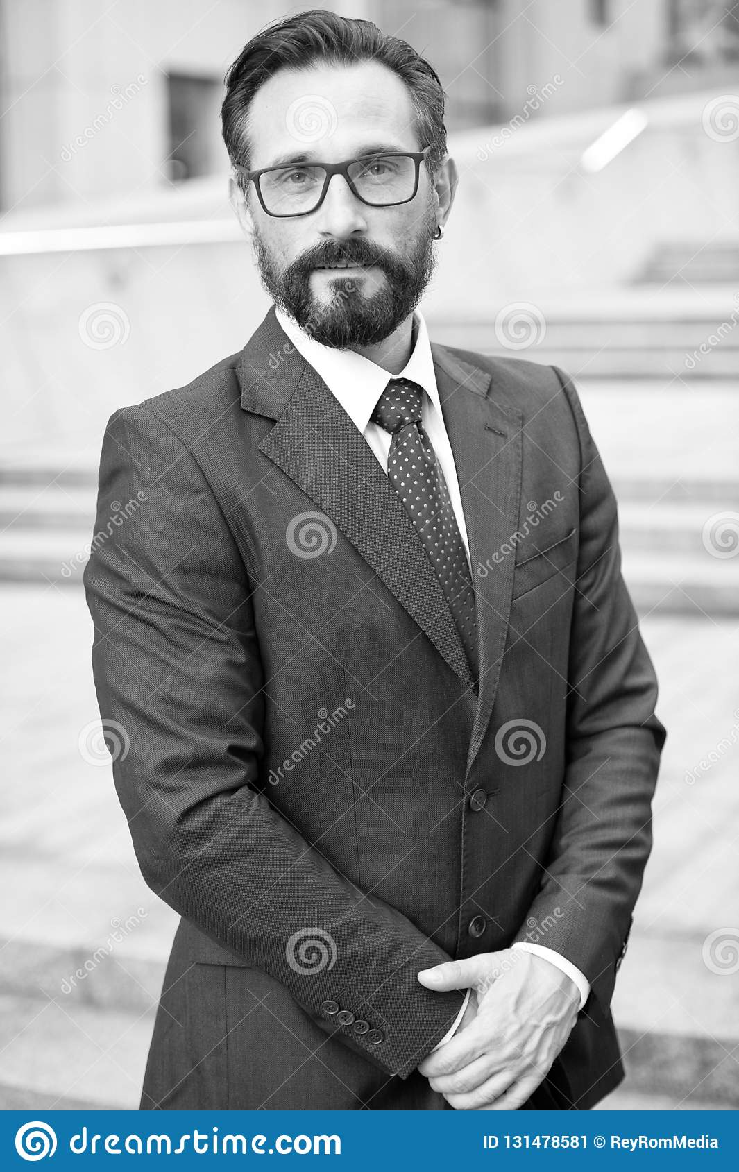 ac415944f9 Businessman outdoor on business center background. Successful business  person black and white portrait. Professional people with beard outdoor  isolated
