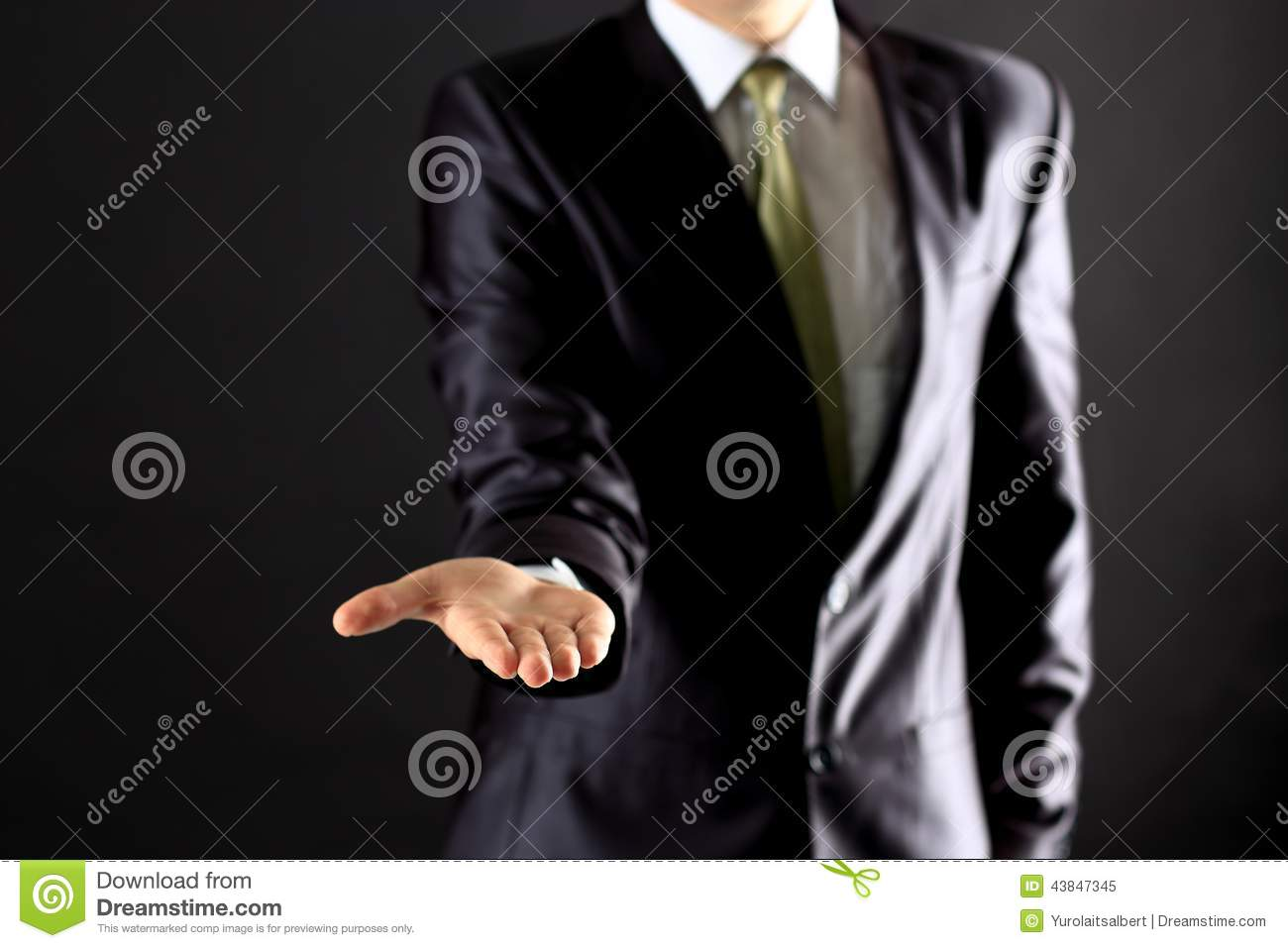 Businessman performing a hand