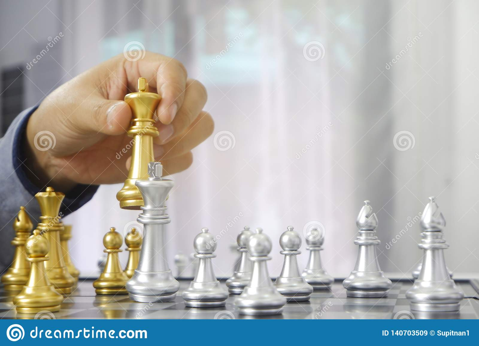 Businessman playing chess game; for business strategy, leadership and management concept