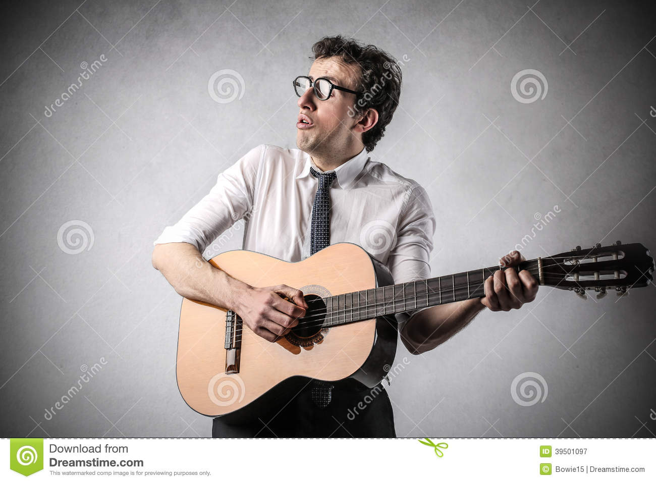 Businessman playing the guitar