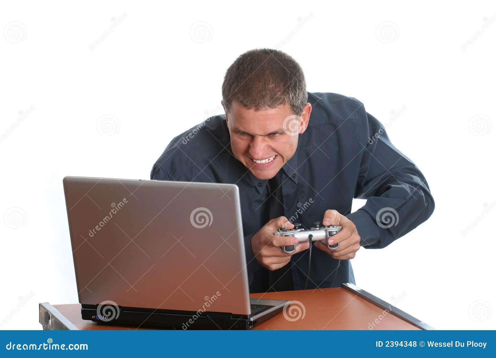 Businessman playing on laptop