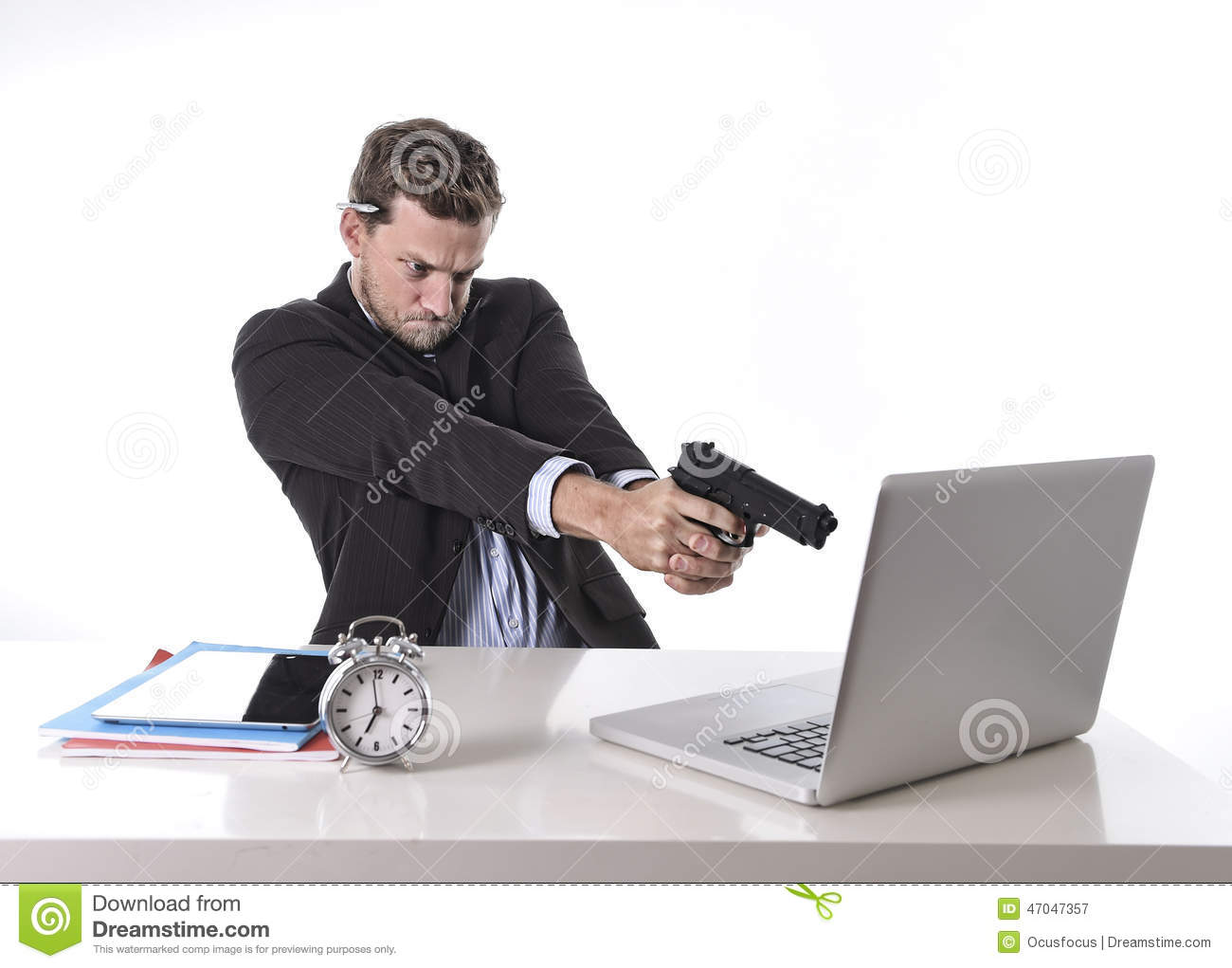 Businessman pointing gun to computer in overwork and overtime work