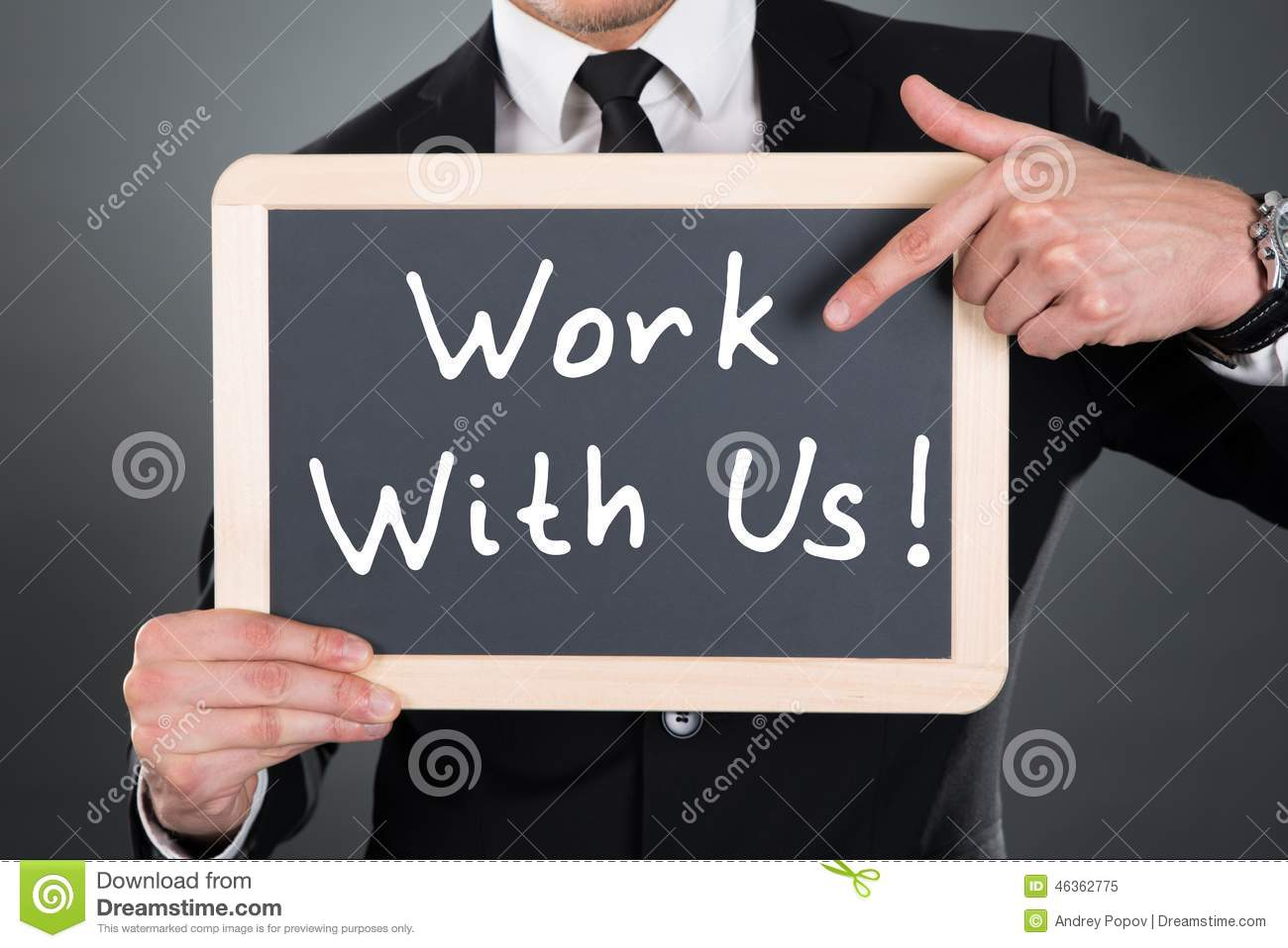 Businessman pointing work with us sign on slate