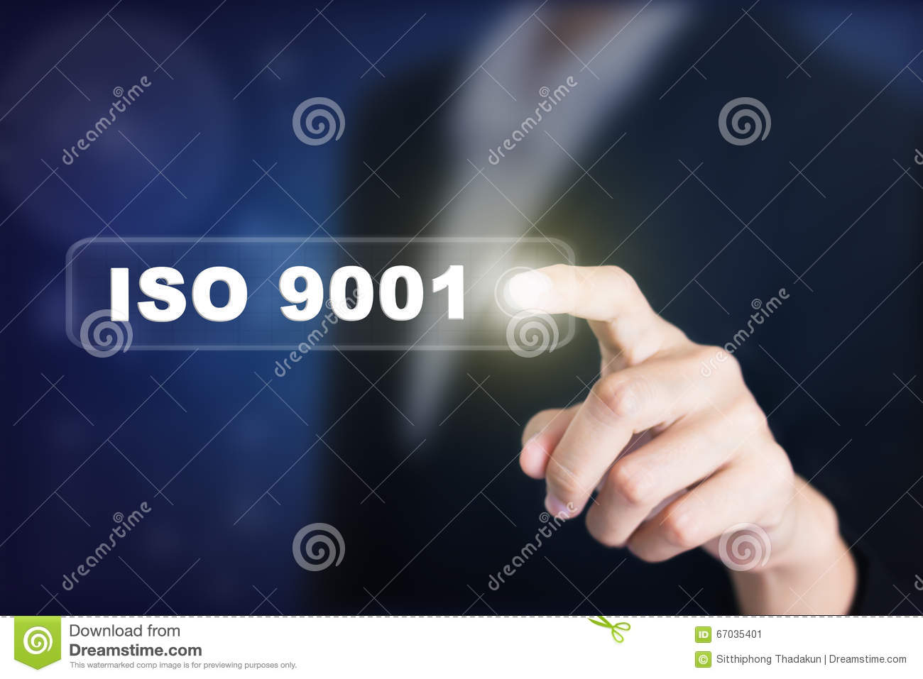 Businessman pressing a ISO 9001 concept button.