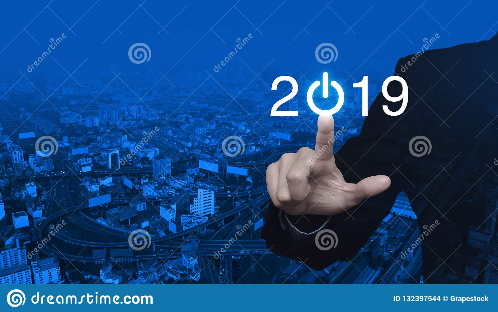Businessman pressing 2019 start up business icon