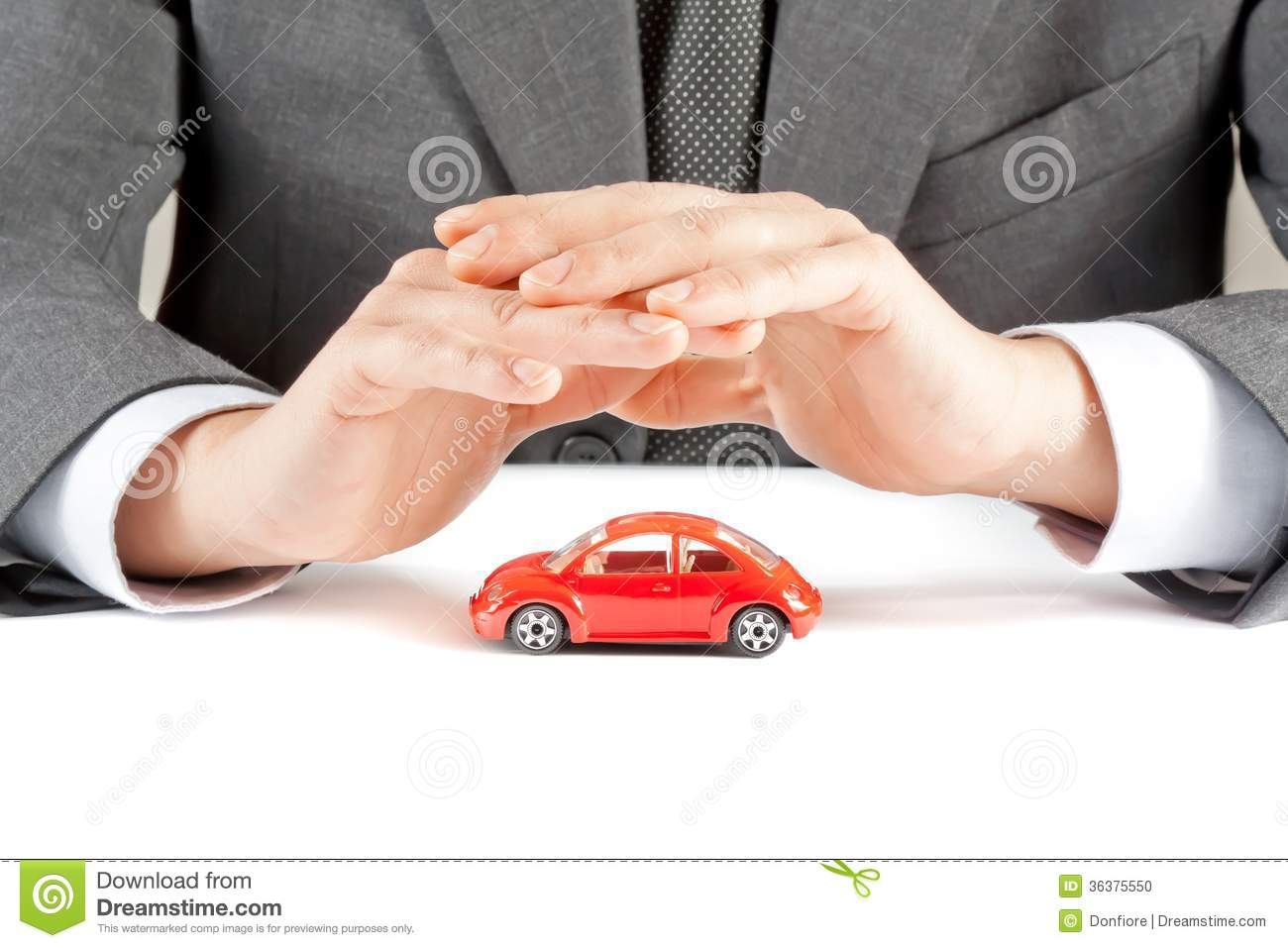 protect with his hands a red car on white table, concept for insurance
