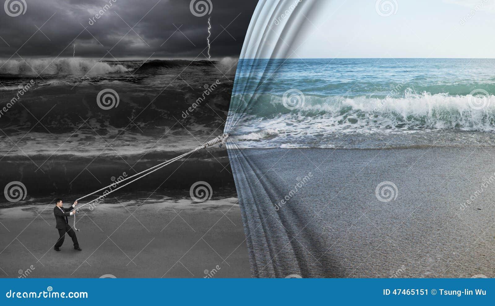 businessman pulling open calm sea curtain covered dark stormy ocean