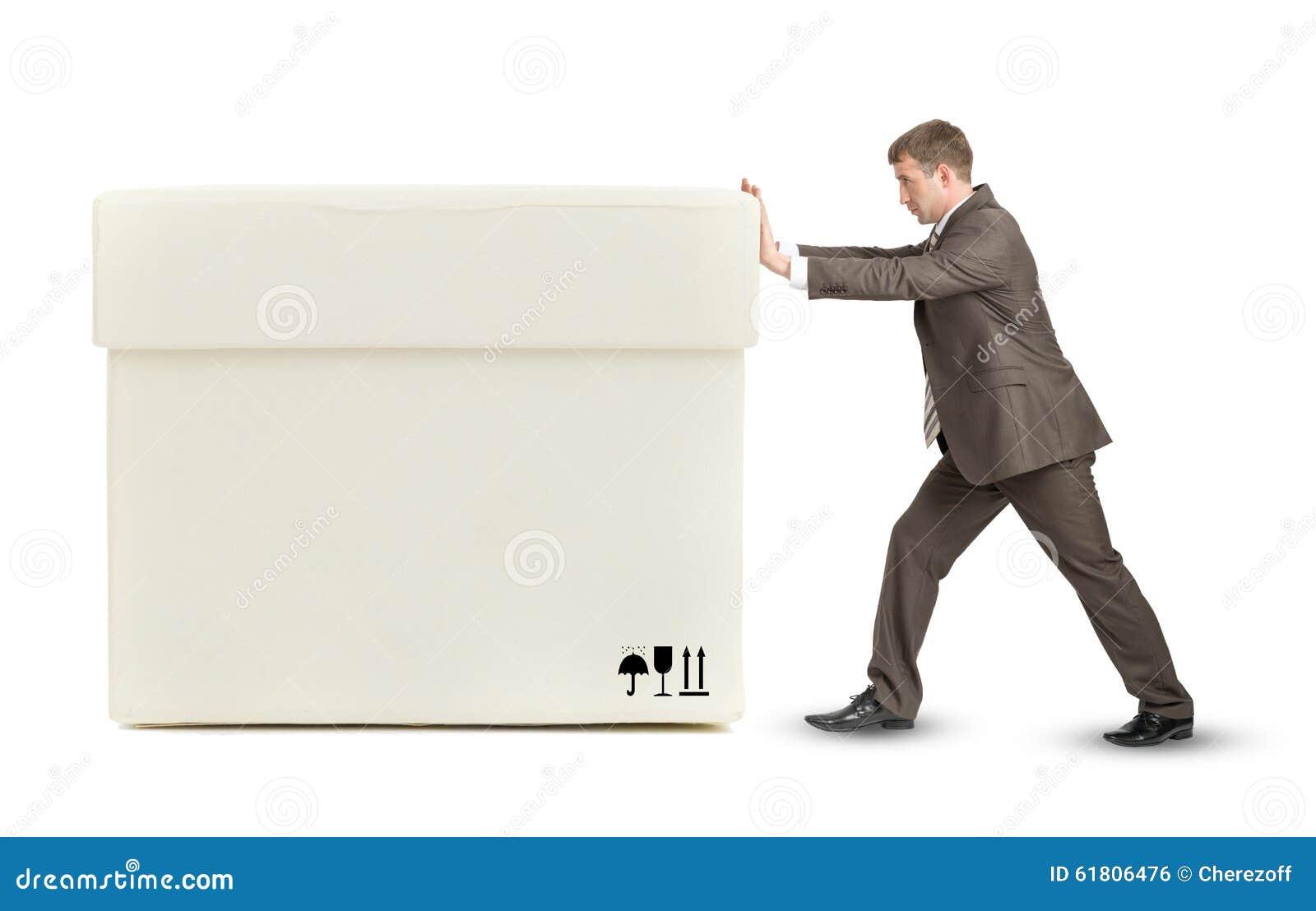 businessman pushing big white box stock photo image. Black Bedroom Furniture Sets. Home Design Ideas