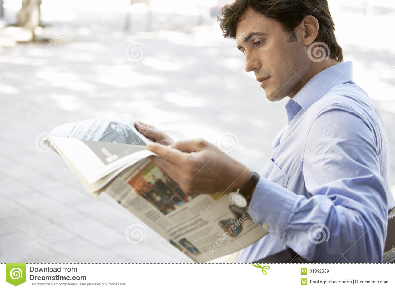 businessman reading newspaper on bench stock photo 31832369 - megapixl