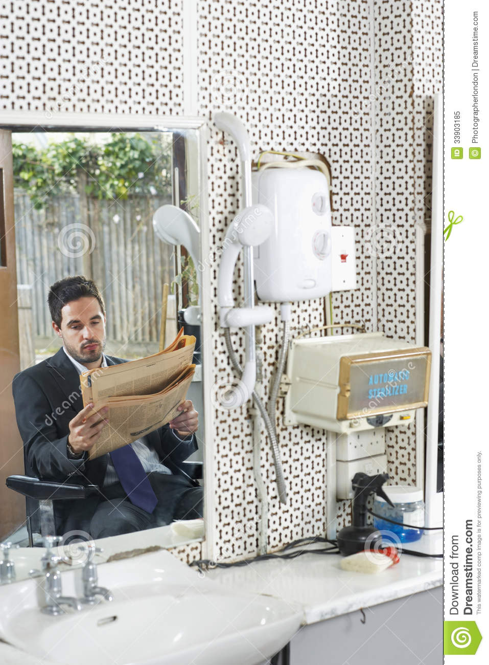 Businessman reading newspaper in hair salon royalty free for Reading beauty salon