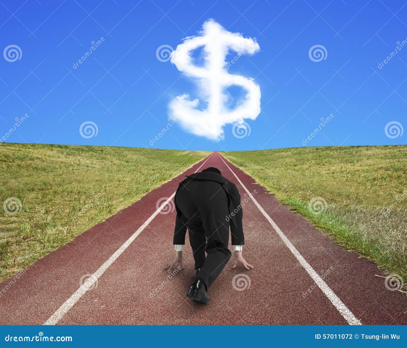 Businessman ready to race on running track toward dollar sign