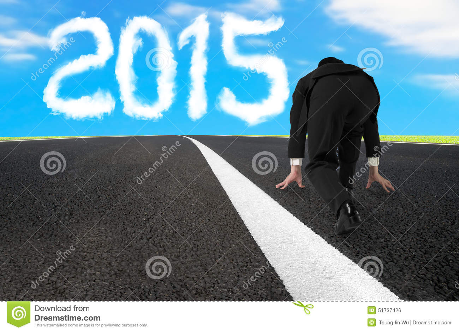 Businessman ready to run on asphalt road with 2015 cloud