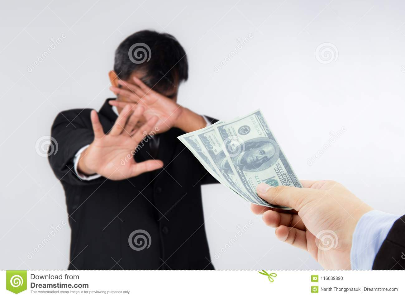 Businessman refuses to receive money - no bribery and corruption concept.