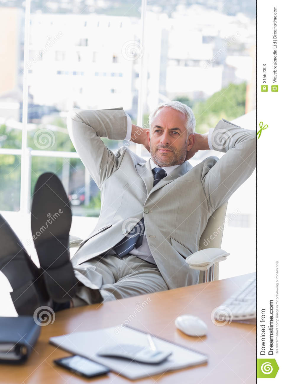 Businessman Relaxing At His Desk Stock Photos Image