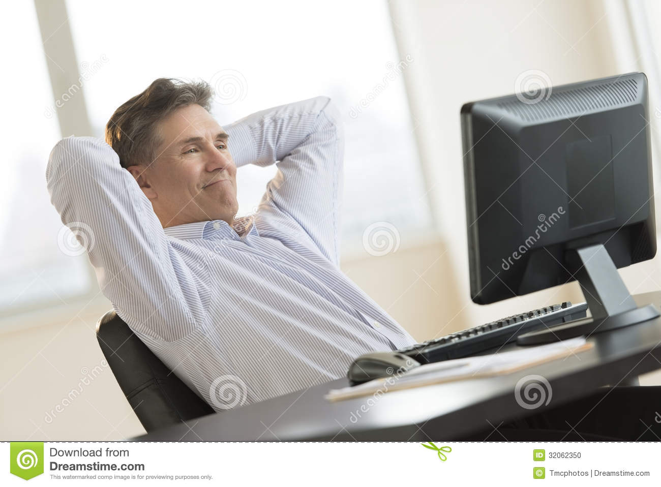 Businessman Relaxing While Looking At Desktop Pc Stock