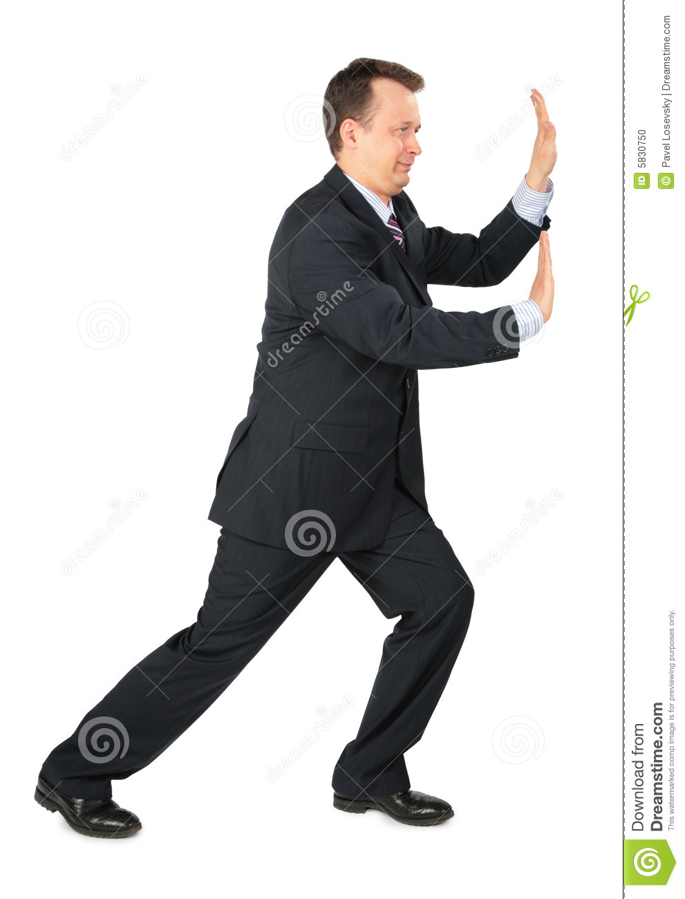 Businessman rests hands against wall