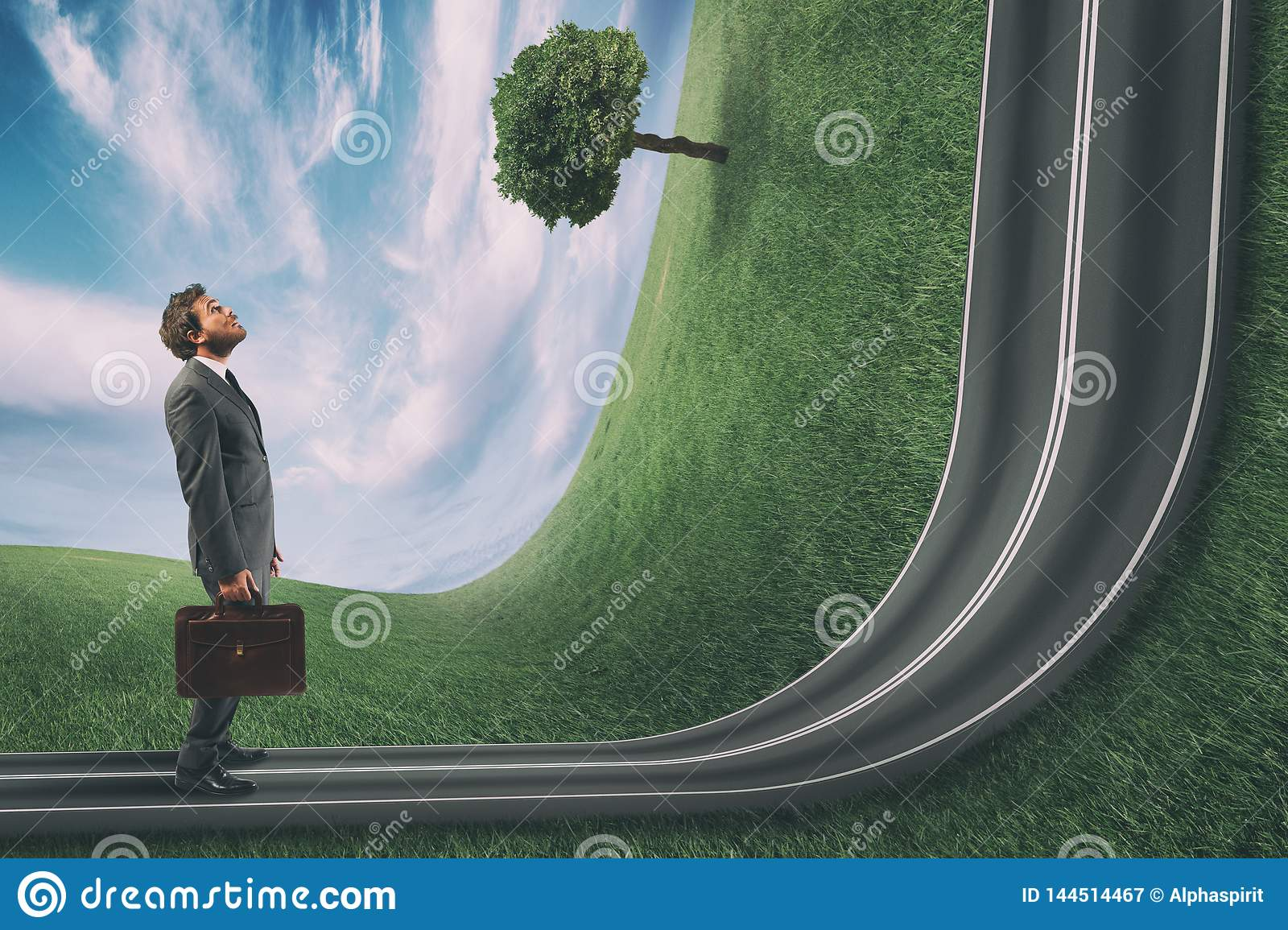 Businessman observes the road uphill in front of him. Achievement business goal and difficult career concept