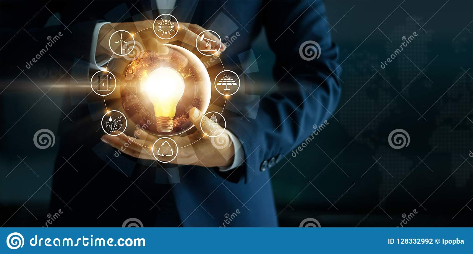 Businessman holding glowing light bulb with energy sources icon