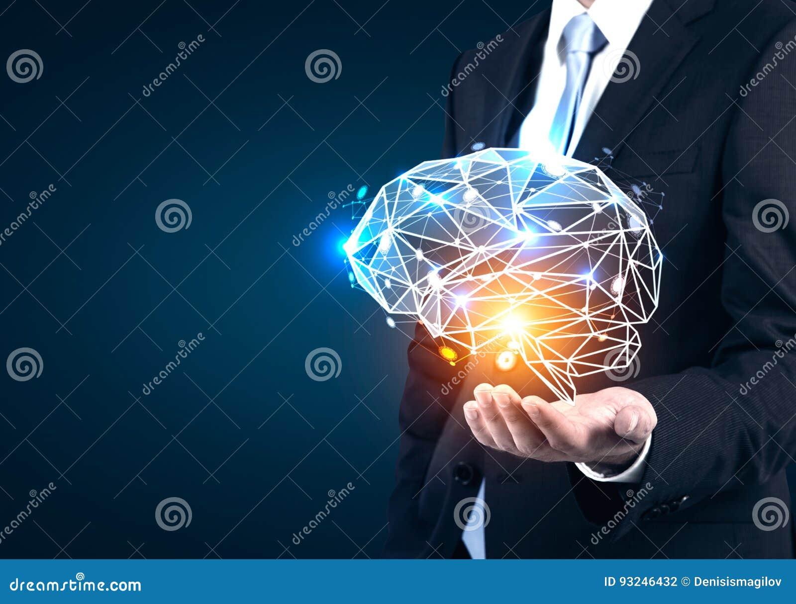 Technology Management Image: Businessman S Hand Holding Holographic Brain Stock Photo