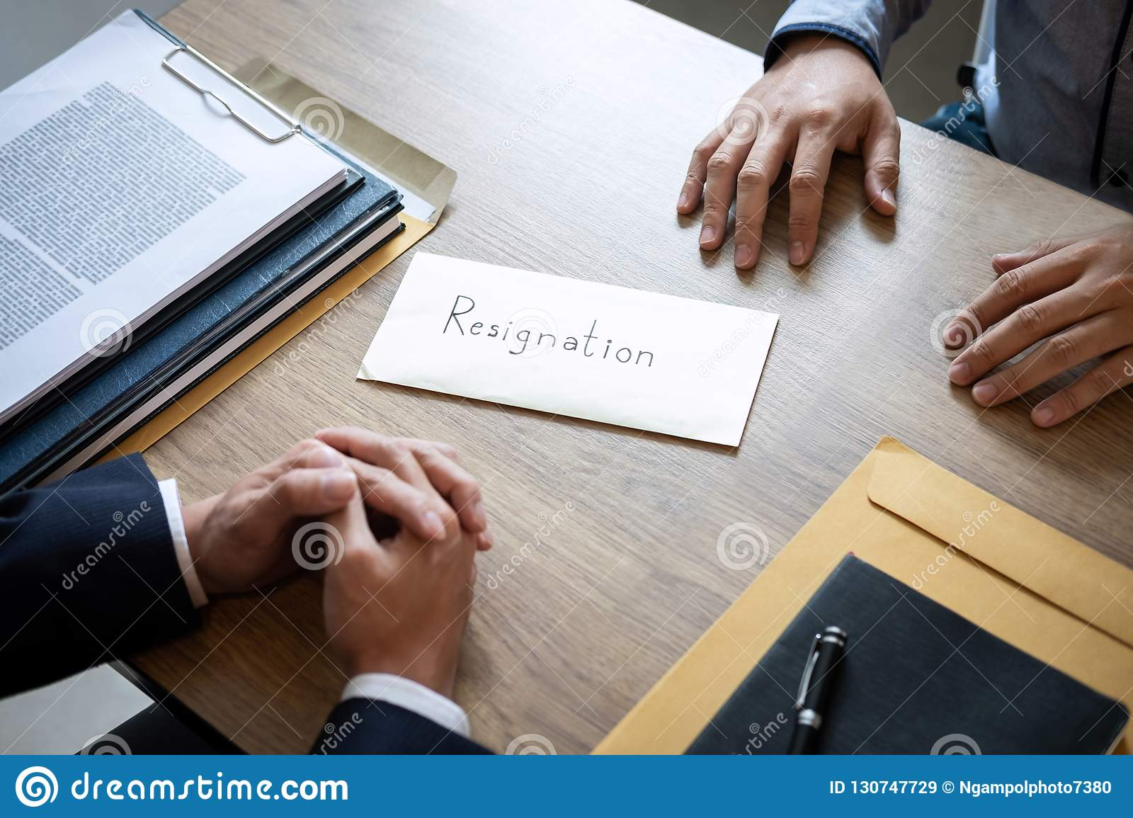 Businessman Sending A Resignation Letter To Employer Boss In Order To Dismiss Contract Changing And Resigning From Work Concept