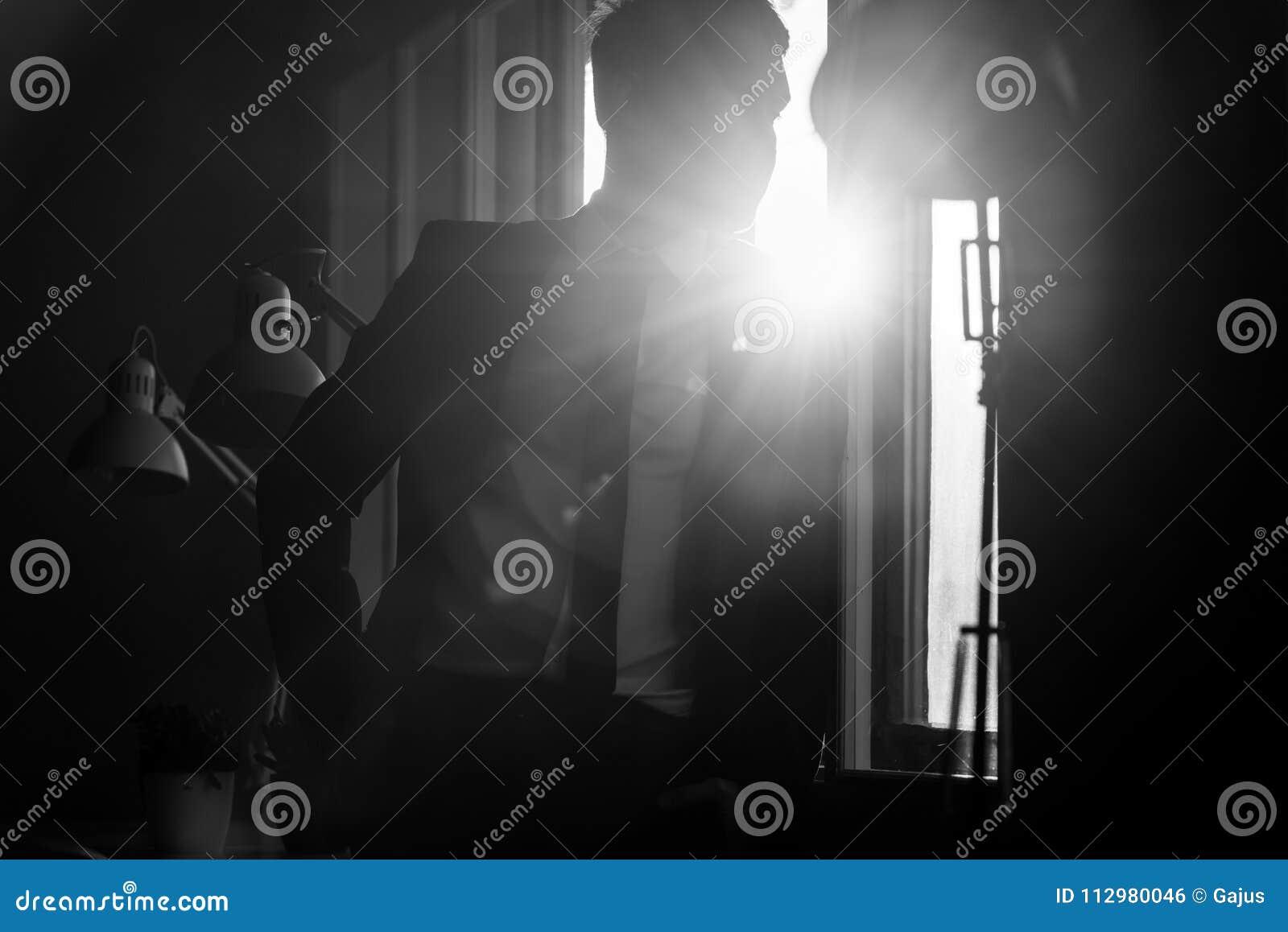 Businessman in a shadowy office