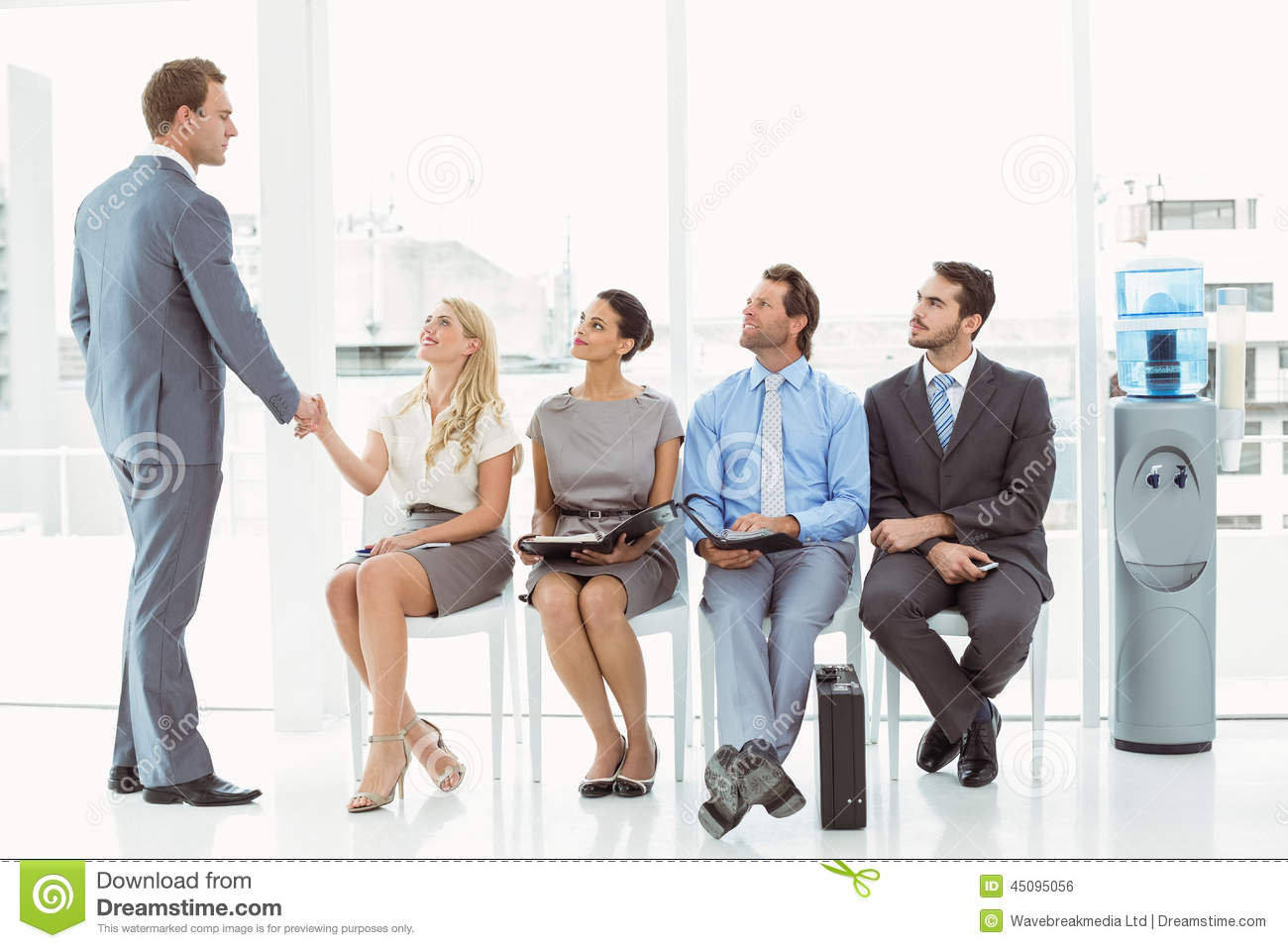 Businessman Shaking Hands With Woman Besides People